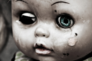 Concept: Abandoned Person. Close up of an old doll`s face with t